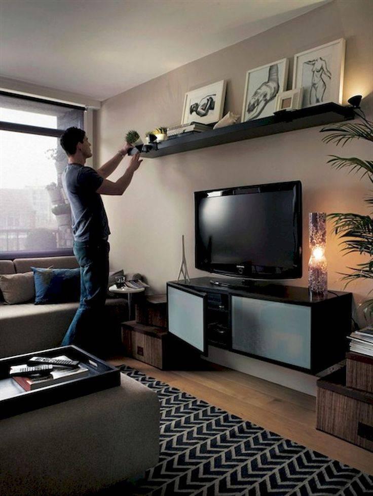 Подбираем высоту установки телевизора на стену в спальной комнате