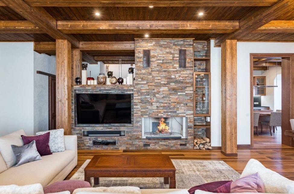 Интерьер гостиной с камином в частном доме: нюансы оформления и стильные решения