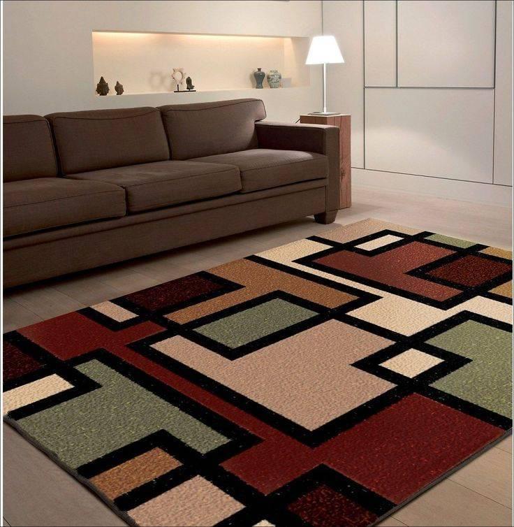 Современный ковер в гостиной - фото примеров