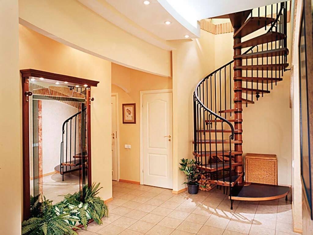 Дизайн прихожей с лестницей в частном доме: особенности, виды, материалы изготовления