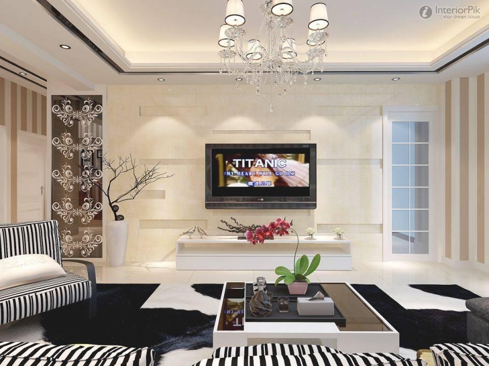 Варианты оформления телевизора на стене в гостиной: инструкции