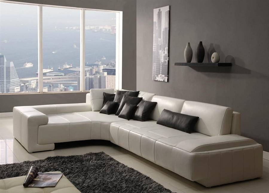 Современные угловые диваны в интерьере гостиной комнаты