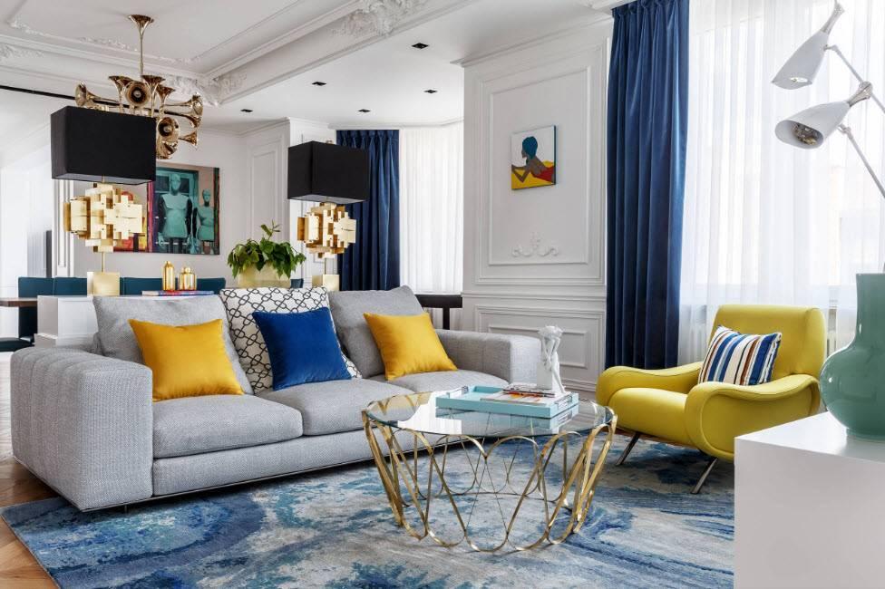 Особенности и недостатки дизайна интерьера гостиной с синим диваном